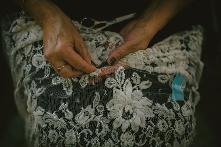 A staff member at Sophie Hallette factory, working on some lace: Dmitry Kostyukov for The New York Times