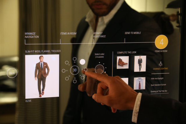 Polo Ralph Lauren associate trying out the interactive fitting room. Thomas Iannaccone